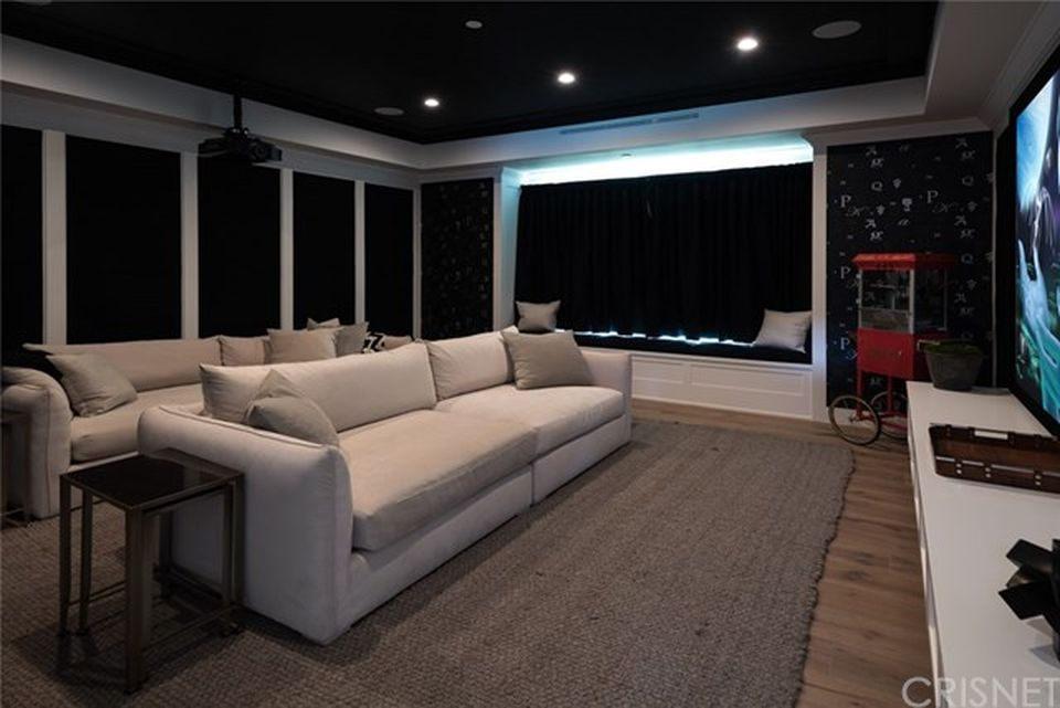 Home Movie Theater Designs That Fall In The Mid Range Tend To Overdo It  With The White Upholstery.